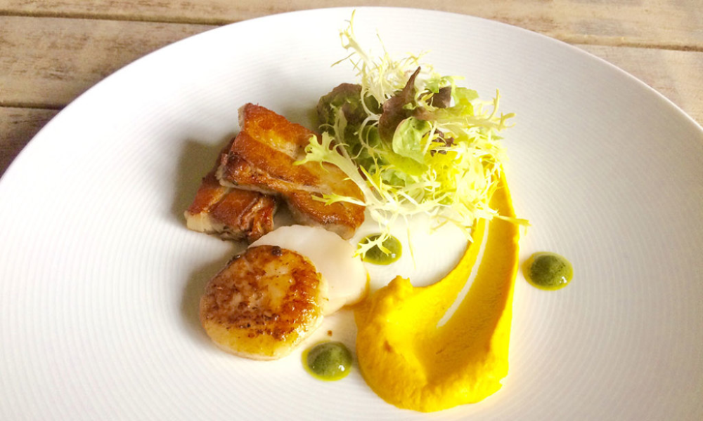 Confit Belly Pork, pan fried scallops, carrot and fennel puree with a cider mustard and sorrel dressing
